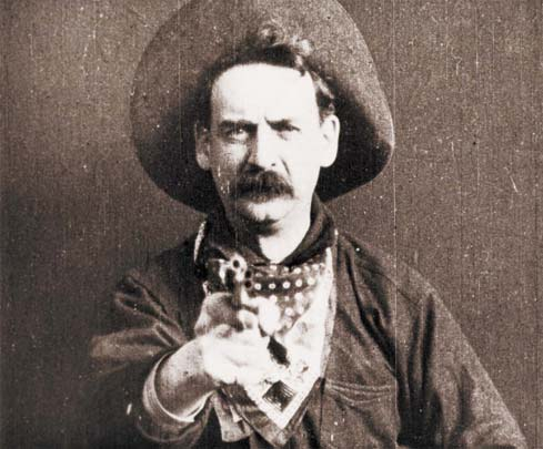 Edwin S. Porter — The Kobal Collection Screenshot from The Great Train Robbery (1903) – Public domain
